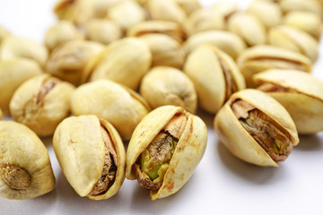 Pistachio nuts on white background : healthy food concept.