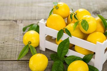 Fresh lemons in the crate