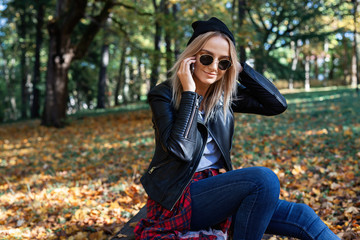 young woman enjoying autumn outdoors