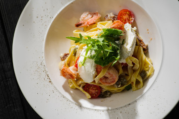 Tagliatelle with shrimps, arugula, tomatoes and Philadelphia cheese.
