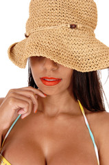 Mystery woman with straw hat in close up
