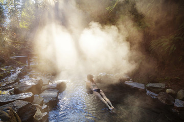 High angle view of woman relaxing in forest hot spring