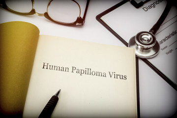 Human papilloma virus, book together to form of diagnosis, conceptual image