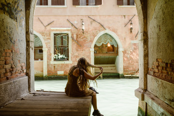 traveling woman in venice italy with long hair