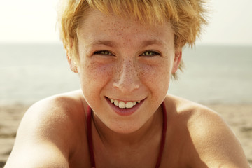 Portrait of smiling boy at beach