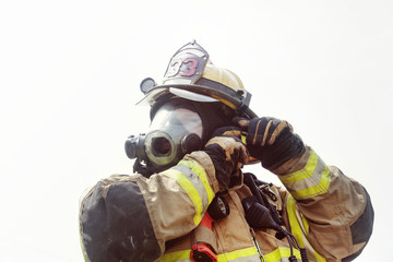 Firefighter wearing gasmask