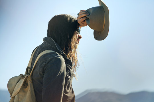 Side view of tired man holding cowboy hat