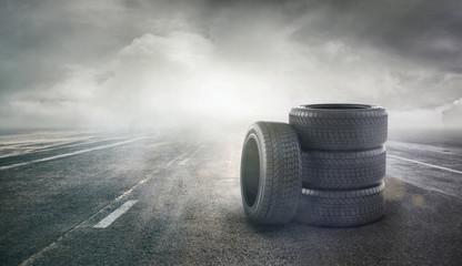 Car tires concept on a road