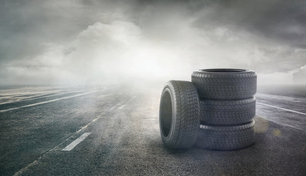 Car tires concept on a road