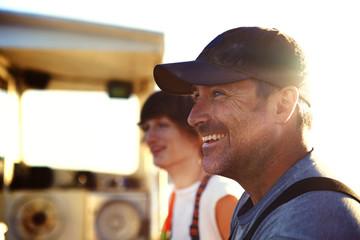 Happy fishermen sitting at trawler