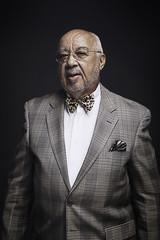 Portrait of confident senior man against black background