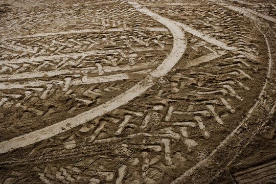 High angle view of tire marks on dirt road