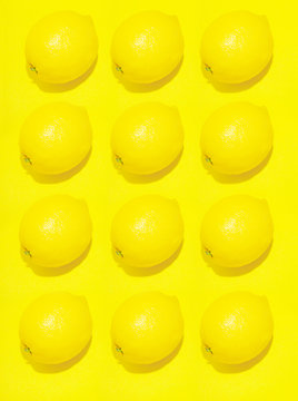 Lemons against yellow background