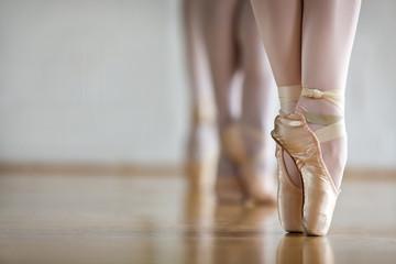 Low section of women practicing in ballet studio