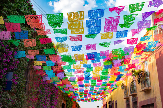 Colorful paper flags over street