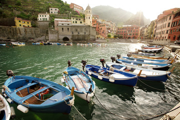 Boats moored against buildings at Vernazza