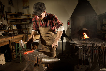 Blacksmith working on metal at workshop