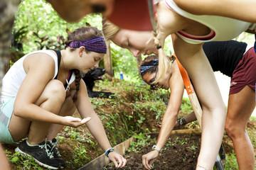 Volunteers sowing seeds in community garden