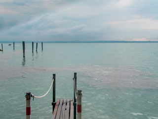 Landscape of the beautiful Lake Garda, Sirmione, northern Italy.A view from the lake to a resort town.