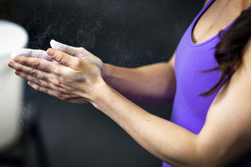 Midsection of woman dusting chalk powder
