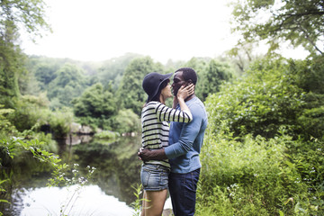 Couple kissing on lakeshore