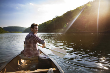 Man looking away while traveling in canoe