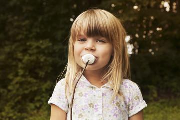 Portrait of girl eating marshmallow