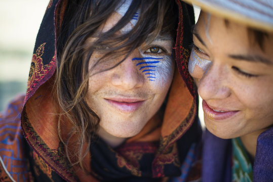 Smiling women with face paint