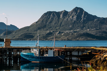 Boat on pier and mountains near Slattnes, Lofoten  Islands