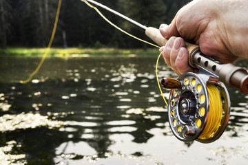 Close up of hand holding fishing rod
