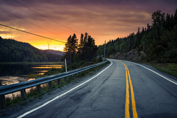 Sunset on the road somewhere in Gaspesie, Quebec, Canada