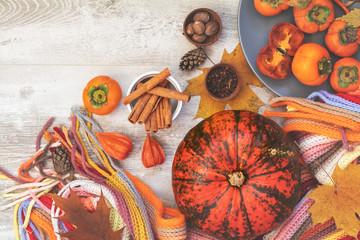 Green and orange Pumpkin, persimmons, ingredients, decorations