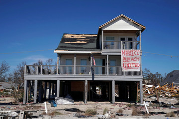 A sign is pictured on a damaged building following Hurricane Michael in Mexico Beach