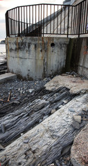 Contaminated water, sewage waste is drained through pipe into sea on an unequipped beach. Pollution of environment, ecological catastrophe. Environmental problem