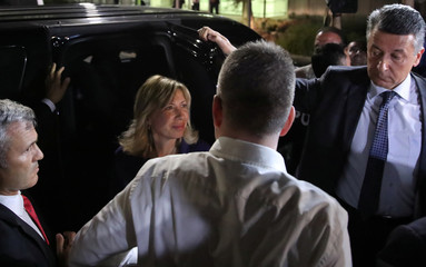 U.S. pastor Andrew Brunson and his wife Norine Brunson arrive at the airport in Izmir