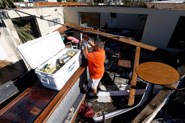 Donathan Fabie salvages beer from his restaurant damaged by Hurricane Michael in Mexico Beach