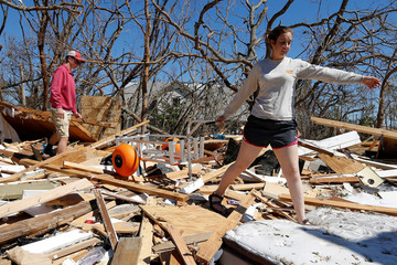 Corey Sykes and his girlfriend Parker Miller search for belongings in debris caused by Hurricane Michael in Mexico Beach