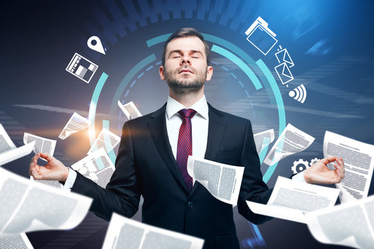 Meditating businessman, paperwork overload
