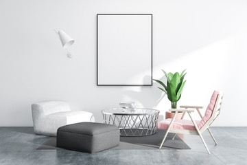 White living room with armchairs and poster