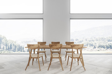 White dining room interior, mountain view