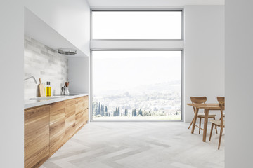 White kitchen and dining room interior, window