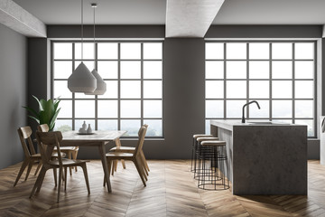 Gray kitchen interior, island and table
