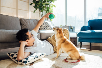 Man and dog at home