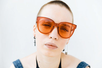 Close up of woman?s portrait with red sunglasses