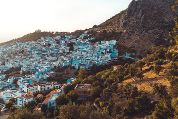 View of Chefchaouen in the mountains - brown soil - from the hill of Jemaa Bouzafar Mosque, Morocco.