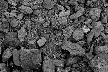 Texture of burnt coal in a fire. gray-black background