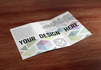 Trifold Brochure on Wooden Table Mockup