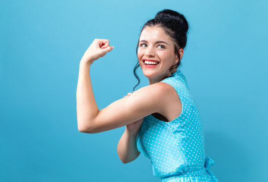 Powerful young woman in a success pose