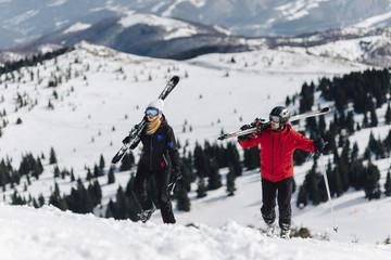 Young couple of freeriders Walking on the Mountain
