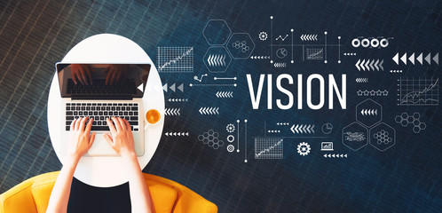 Vision with person using a laptop on a white table
